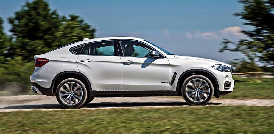 На грунтовке BMW X6 с 20-дюймовыми шинами Run Flat бледноват — весь трясётся, передняя подвеска что-то бубнит.
